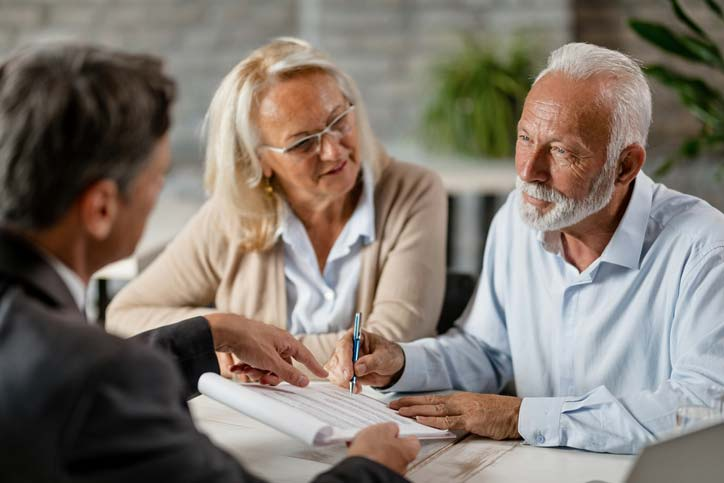 Elderly couple talking with a lawyer, estate planning attorney Connecticut