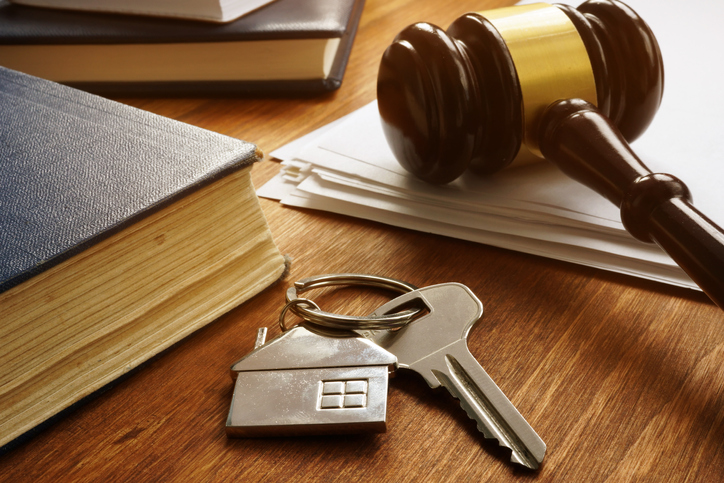 Key from real estate and gavel. Property law concept. Real estate attorney Connecticut